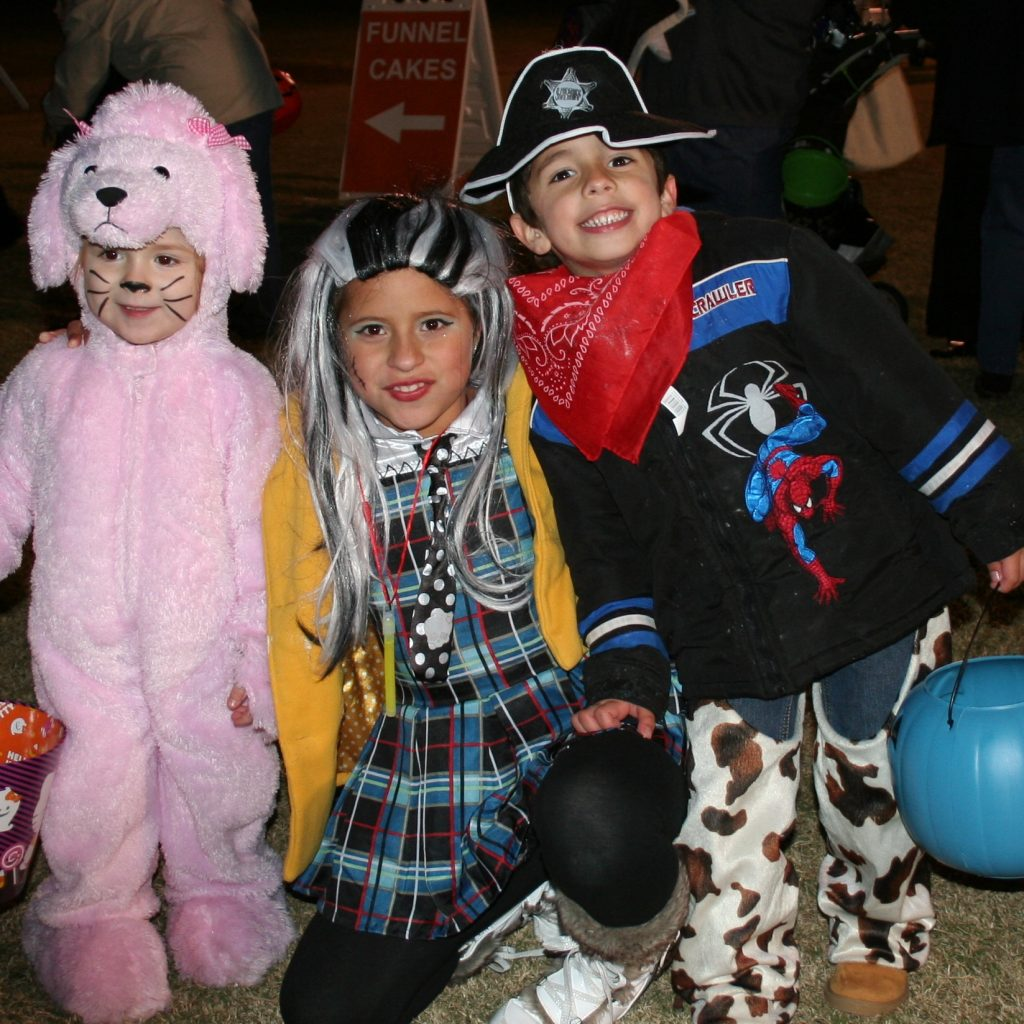 kids in costumes smiling