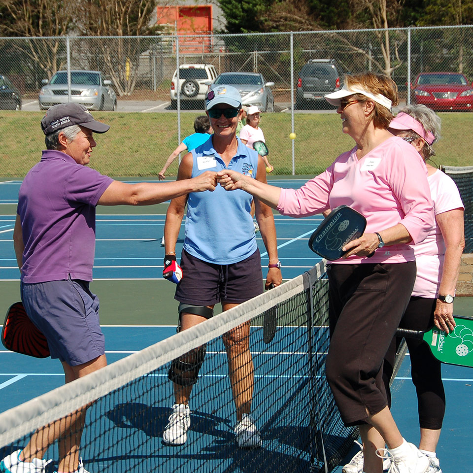group shaking hands after pickle ball game