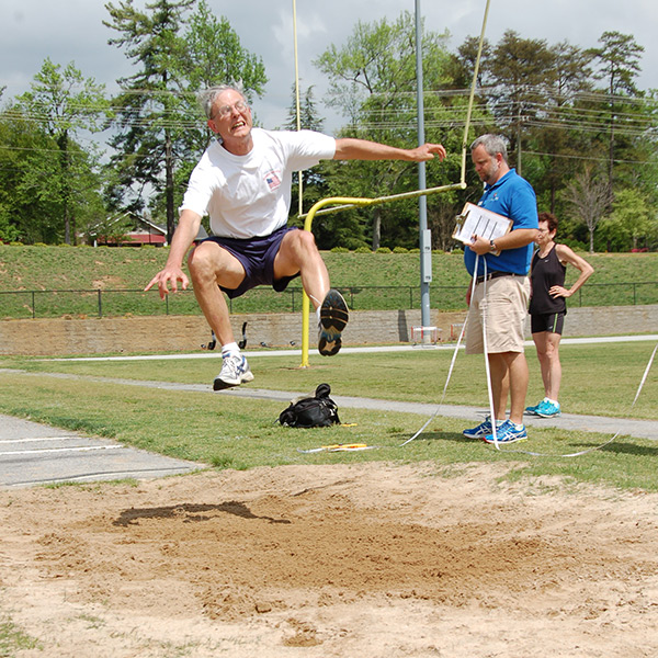 man doing long jump