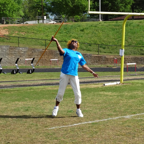 Senior woman throwing javelin