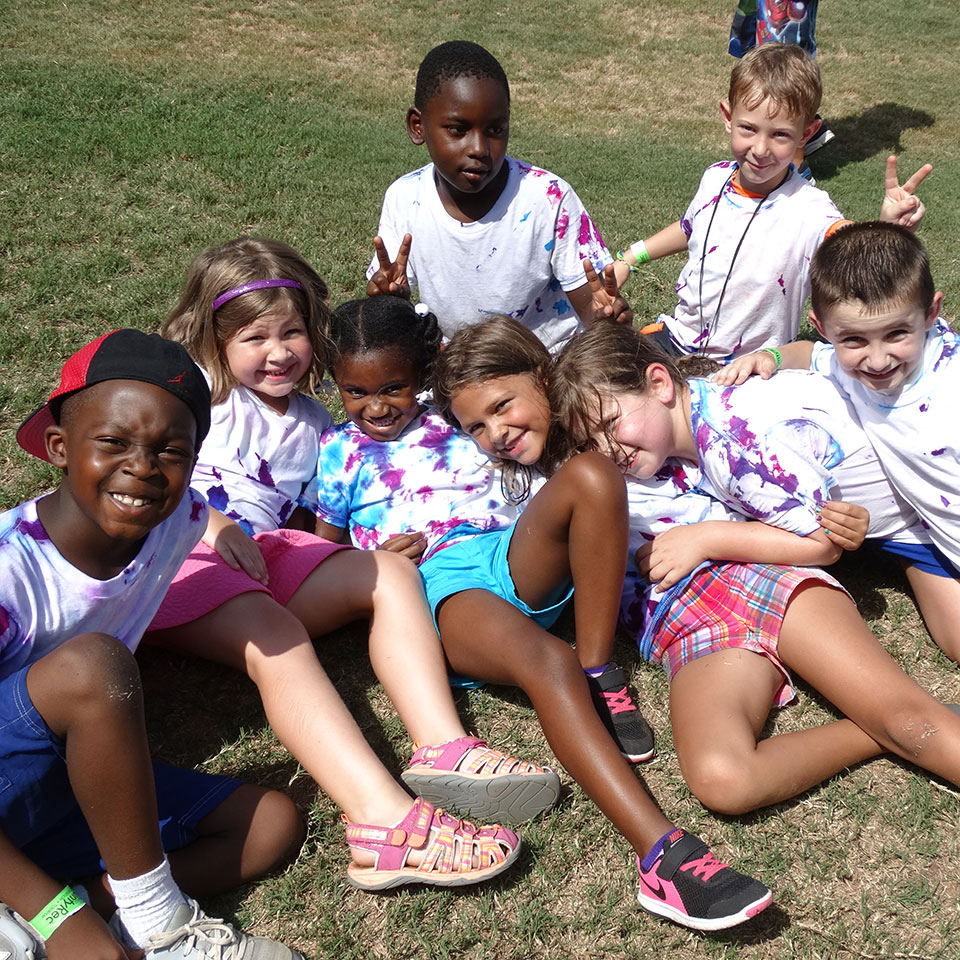 kids wearing home made shirts at camp smiling