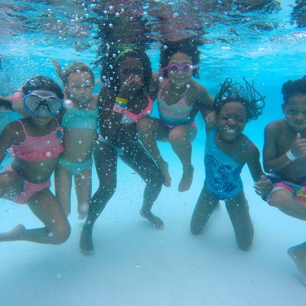 kids underwater at summer camp