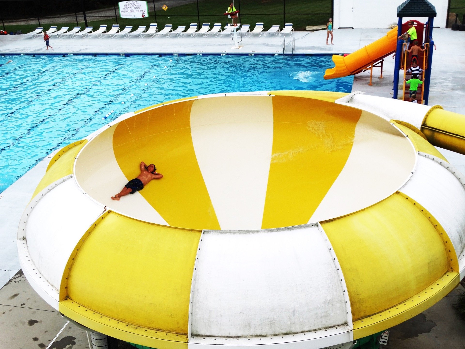 adult enjoying circular water slide