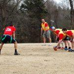 adults playing flag football