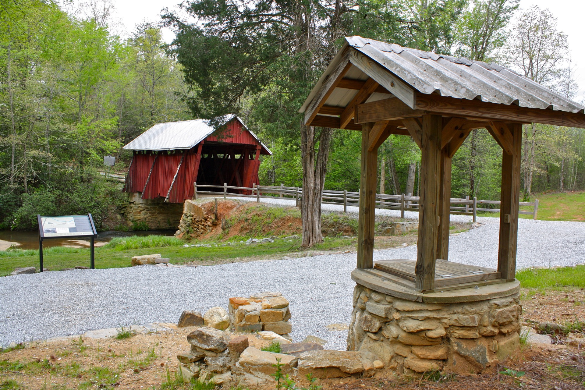 Well with covered bridge in the background