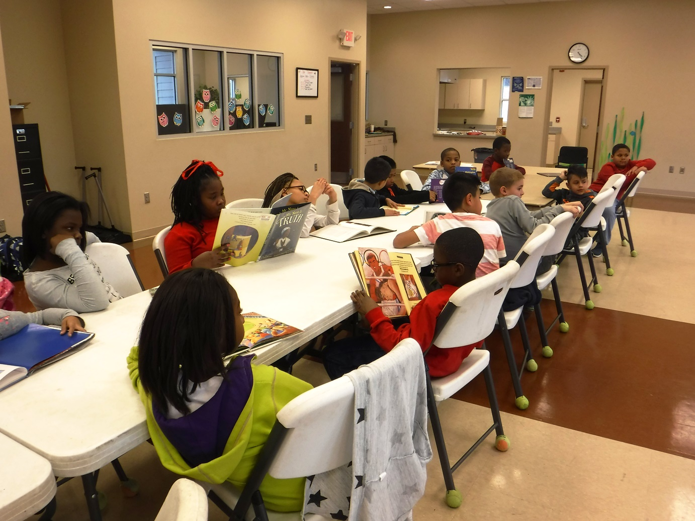 Kids read books from Greenville County Library System