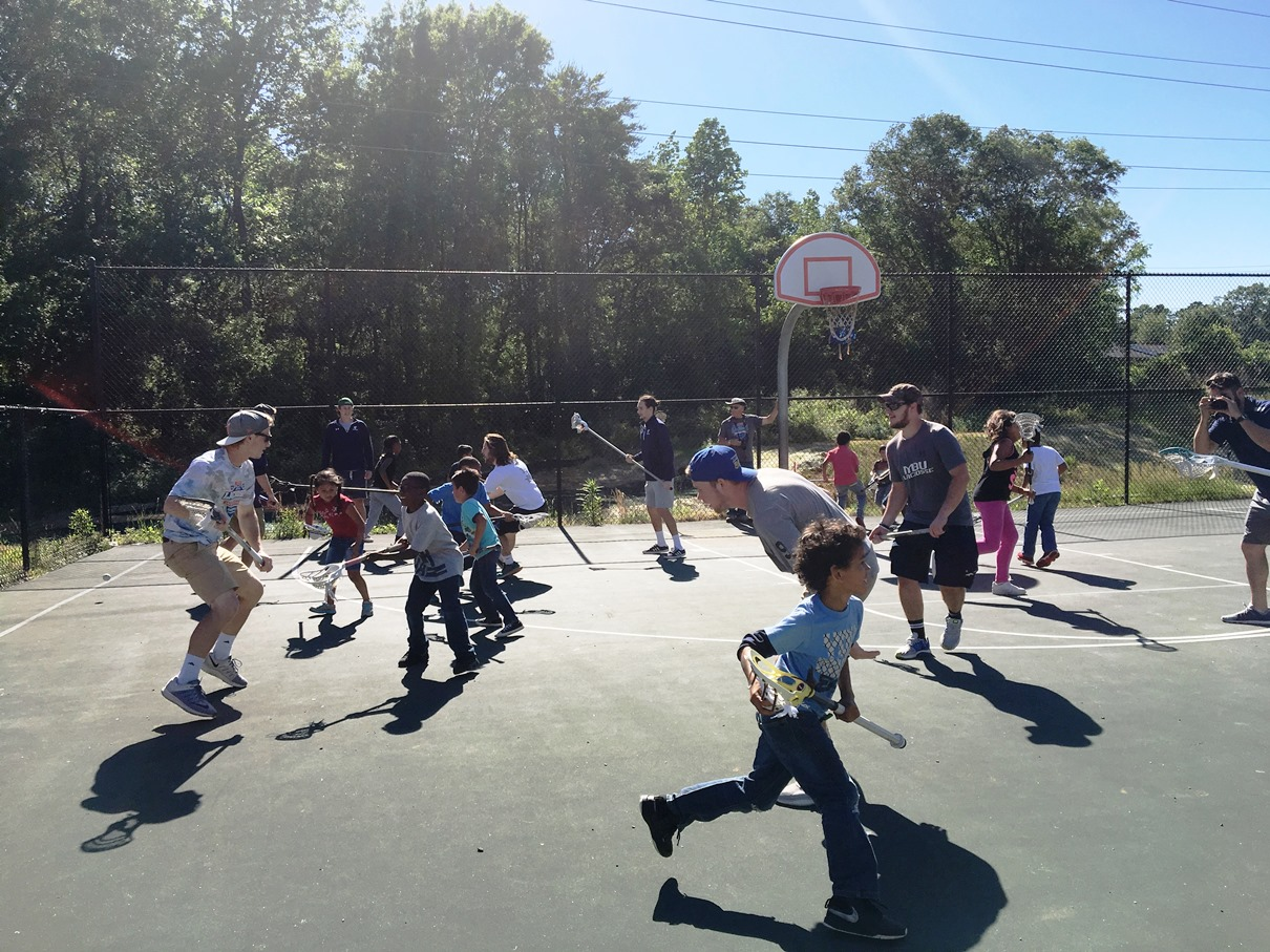 Lacrosse team teaches after-school program kids to play lacrosse