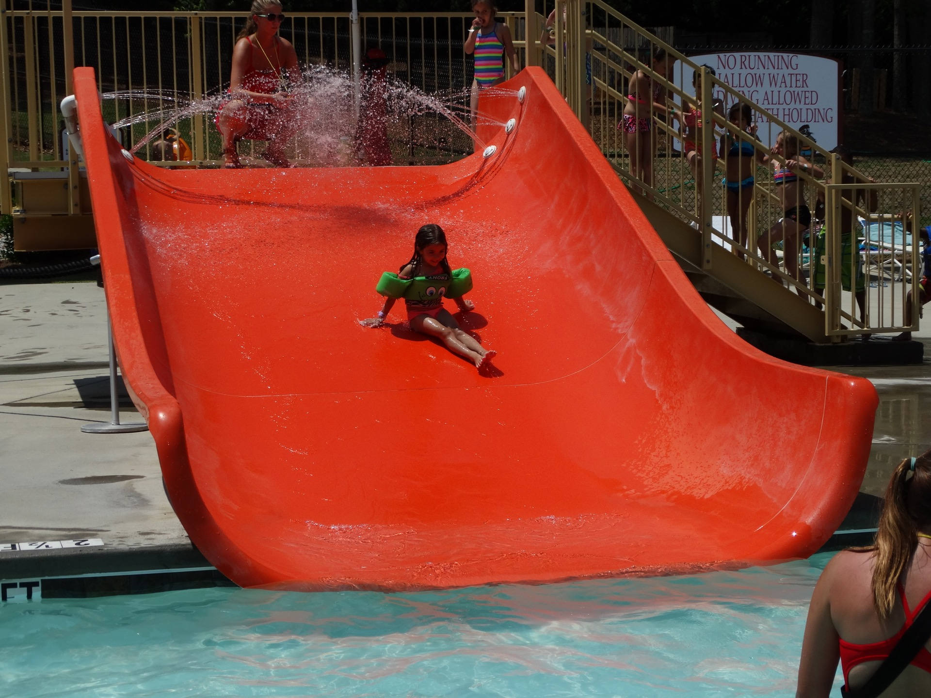 little girl going down waterslide
