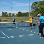 Adults enjoying pickleball