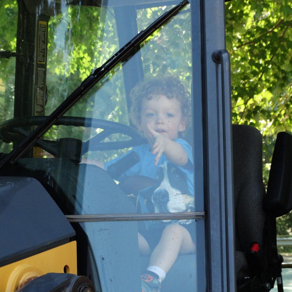 Toddler enjoys touch a truck