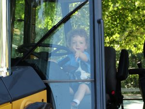 Toddler enjoys touch a truck