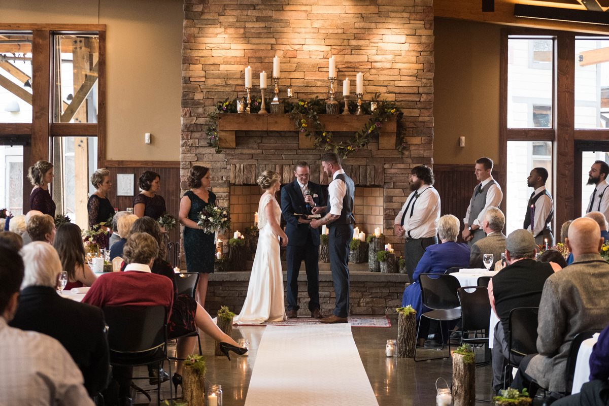 Couple at the altar as audience watches