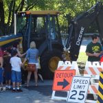 Kids in line to touch truck