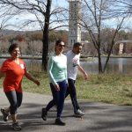 adults walking on Furman campus in the fall