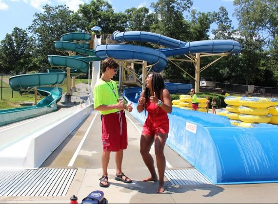 male and female lifeguards laughing
